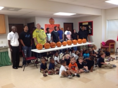 Pumpkin carving with dads at Rougon's Head Start.